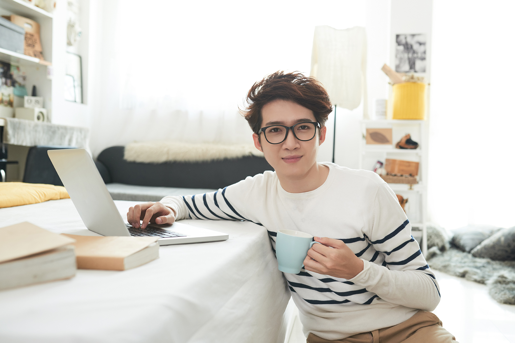 Student in his room